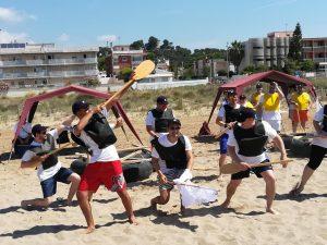 team dancing team building beach activity