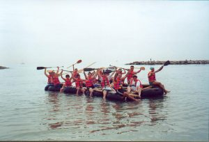 team building activity beach raft race